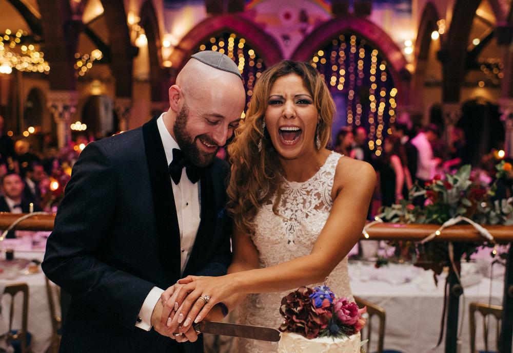 Jewish wedding cutting the cake