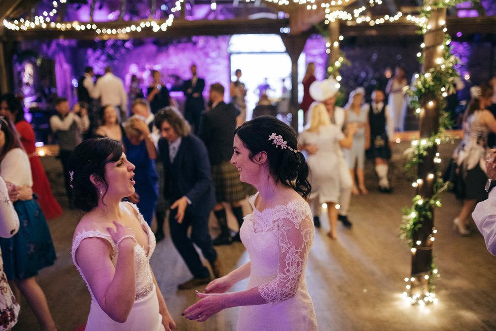 Same sex wedding dancing