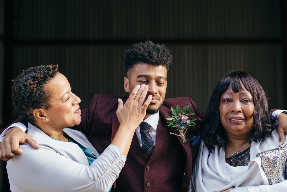 Emotional groom with mum