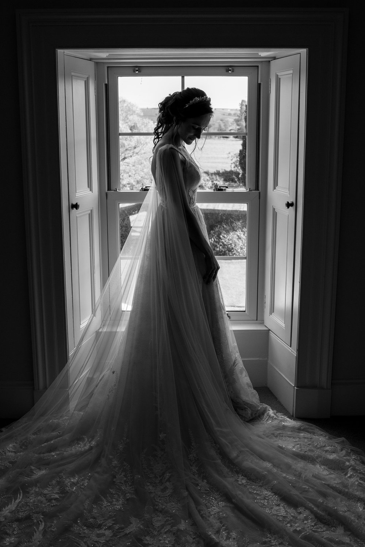 Bride showered by window light