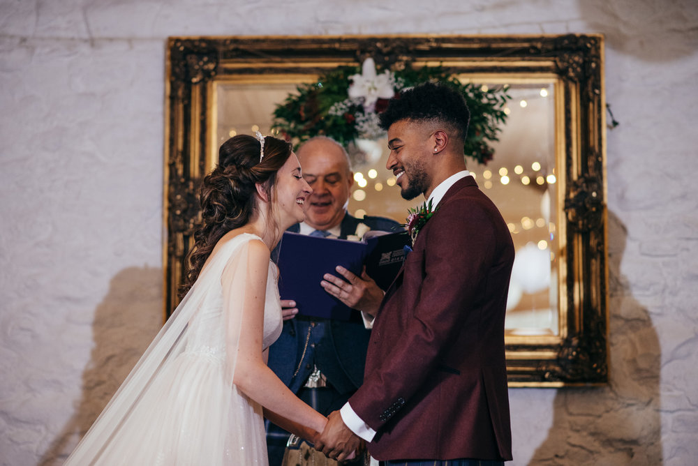 Bride and groom laughter at ceremony