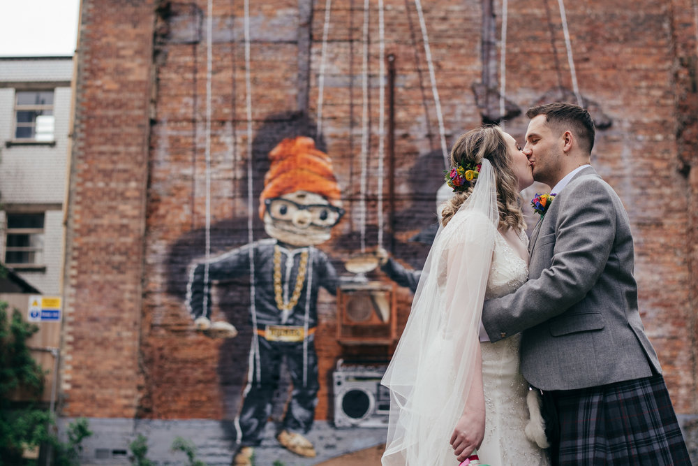 Urban wedding portrait graffiti