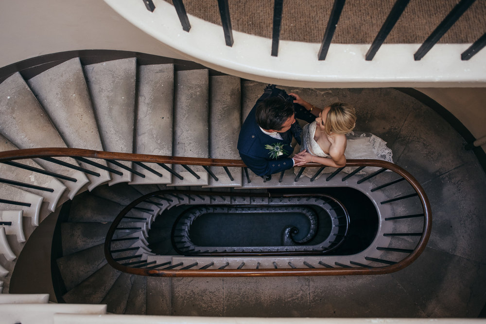 Bride and groom on spiral stairs