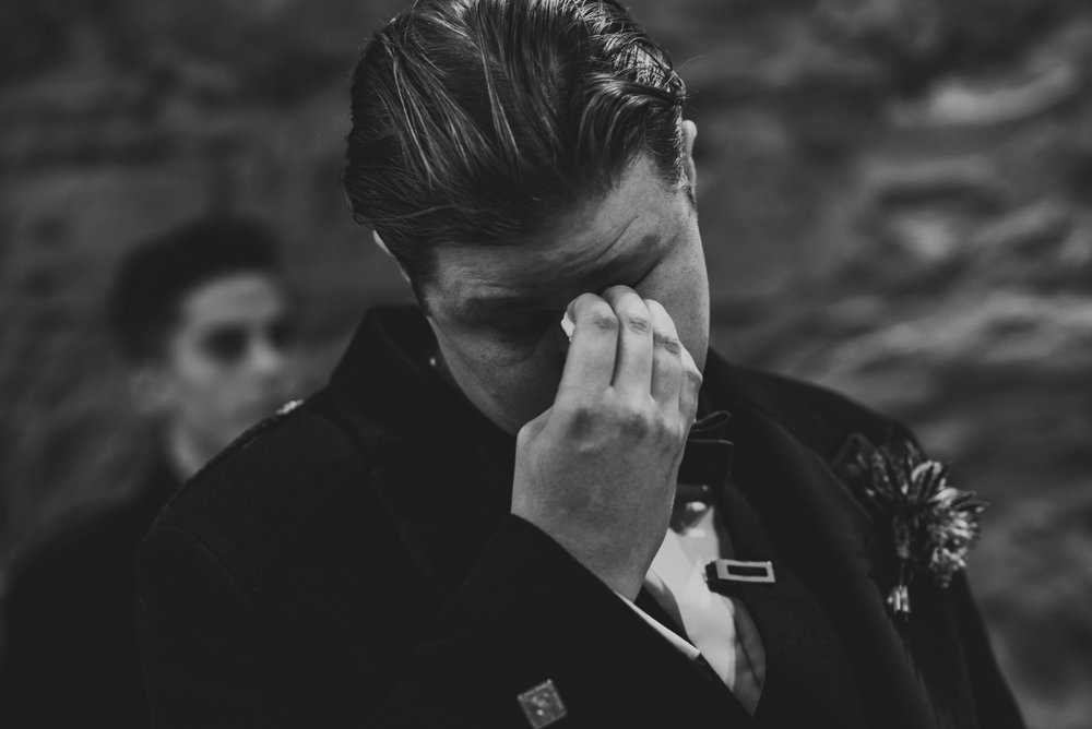 Emotional groom at wedding
