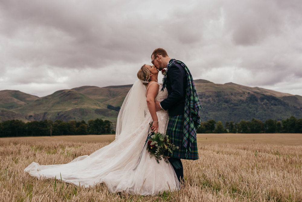 Wedding portrait in a Scottish field