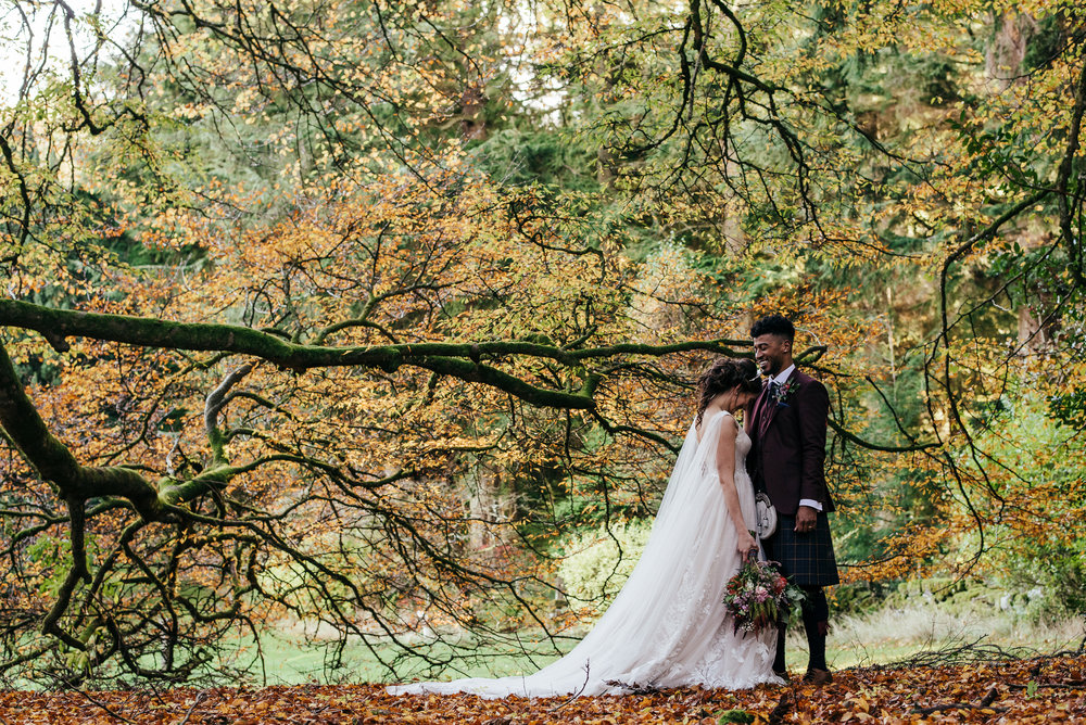 Wedding portrait next to autumnal tree