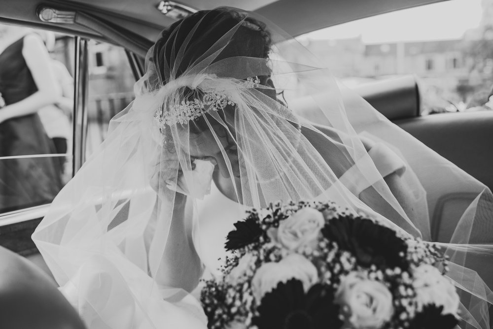 crying bride in car