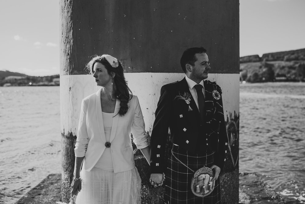 Black and white wedding portrait on pier