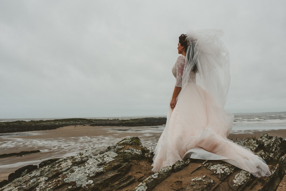 Dramatic bride portrait on beach