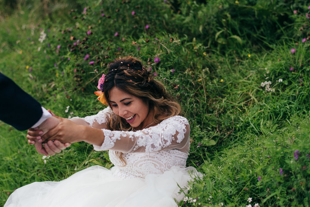 Bride having fun on the grass