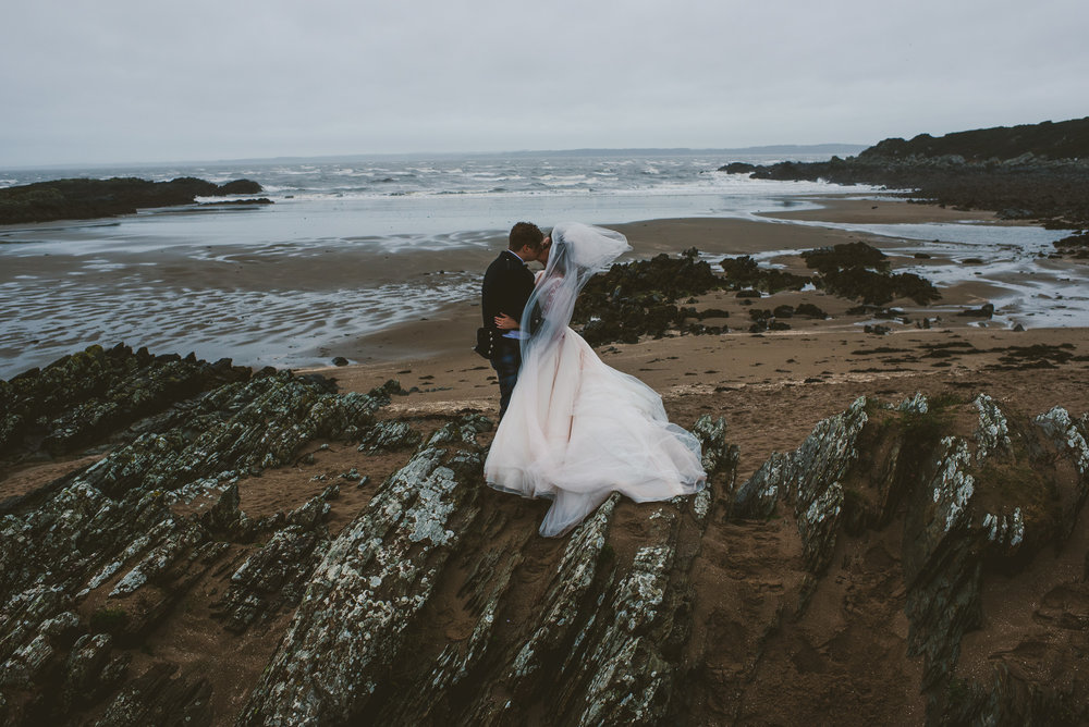 Wedding portrait on windy beach