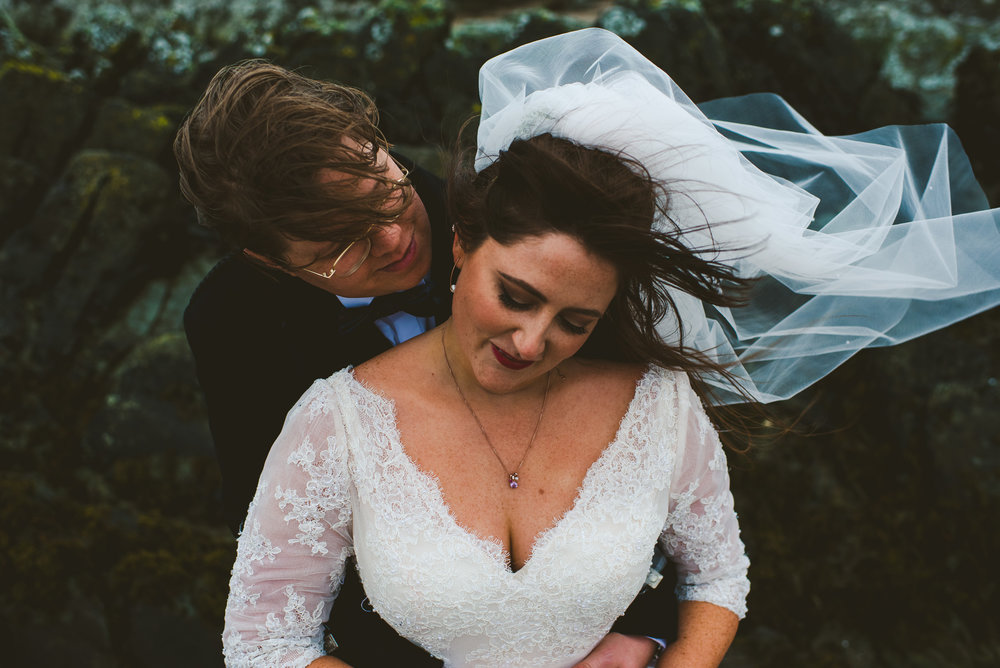 Emotional wind swept wedding portrait