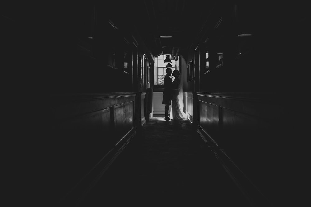Dark corridor wedding portrait
