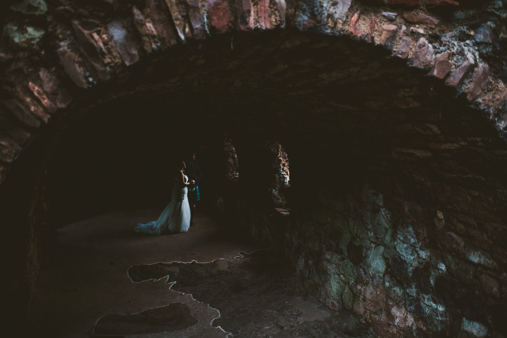 Bride and groom finding light in castle