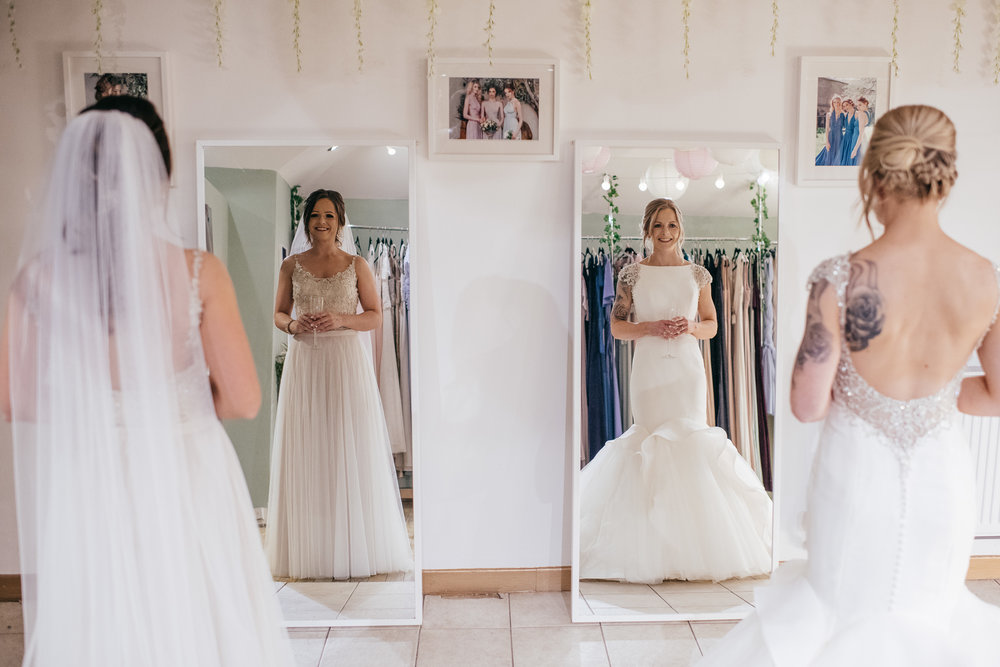 Same sex brides looking in mirror