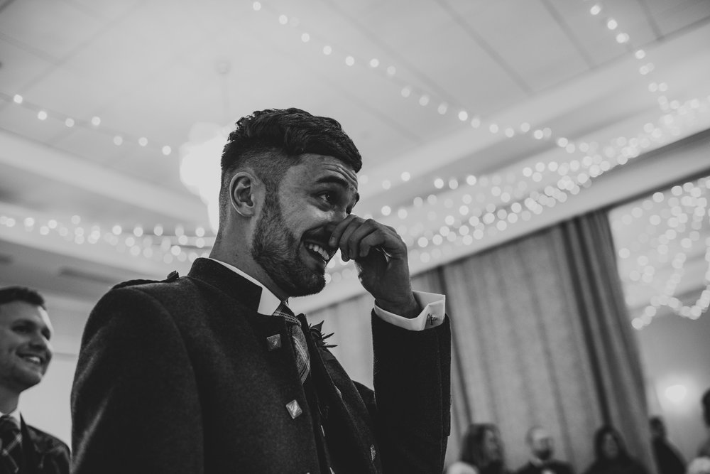Groom emotional prior to ceremony