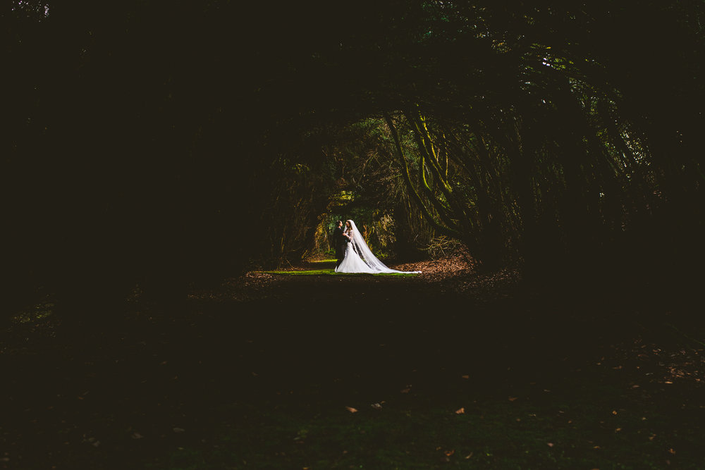Dark woodland wedding portrait