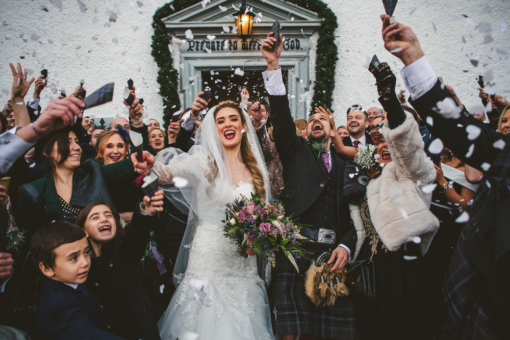 Energetic confetti picture at wedding