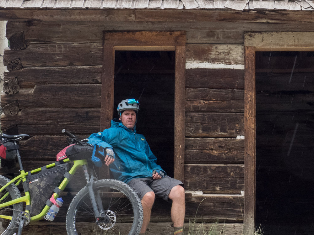 Bedrock Ambassador Brett Davis, waiting for the weather to ease while testing the Moab on a Colorado Trail through-ride.