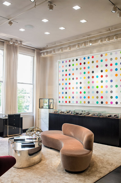 The interior of Material Good, where Rob Ronen, an owner of the watch and jewelry store in SoHo, says that art, like the Damien Hirst painting, enhances the shopping experience.   Credit Damien Hirst and Science Ltd./DACS, London/Artists Rights Society (ARS), New York 2016; Photograph by Daniel Krieger for The New York Times