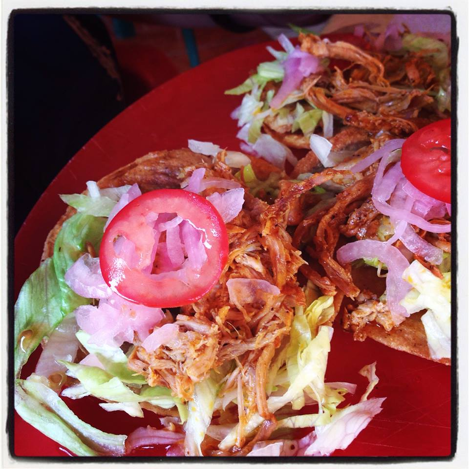 traditional Yucatan meal of panuchos cochinitas pibil