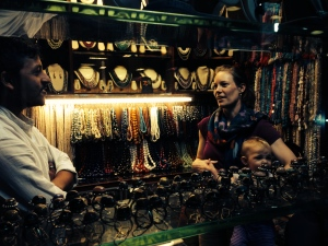 Leah purchasing beads and raw materials from a vendor in Mumbai, India