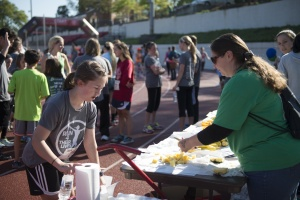 Committed volunteer Tobey Thurston (right) slices up bananas to offer to Run 4 Their Lives Lynchburg participants.