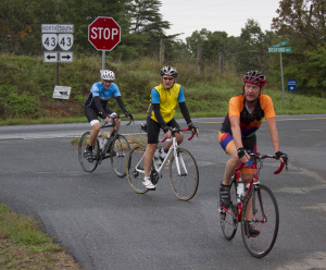 John Carlin, center, rides into an aid station with fellow cyclists during Ride 4 Freedom