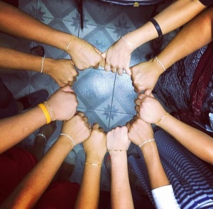 The girls at the Home of New Beginnings proudly wear their bracelets given to them on the 2015 trip.