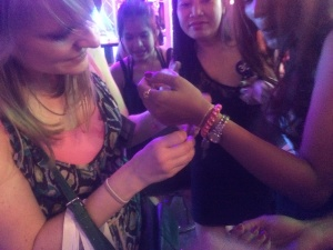 December 2015: Team member, Erin Caswell, places a bracelet on a girl's wrist in a red light district in Bangkok, Thailand.