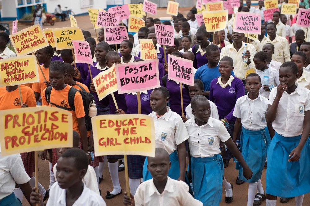 Girls from many different schools in Gulu walking in the March for the Girl Child.