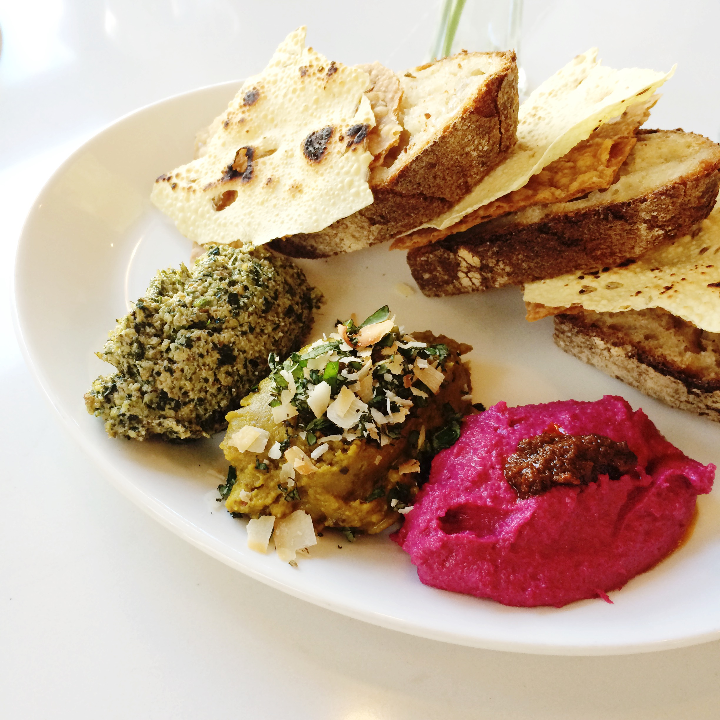 -pecan, kale & feta pesto  -split fava bean dal with mint & coconut -beet hummus with harissa oil