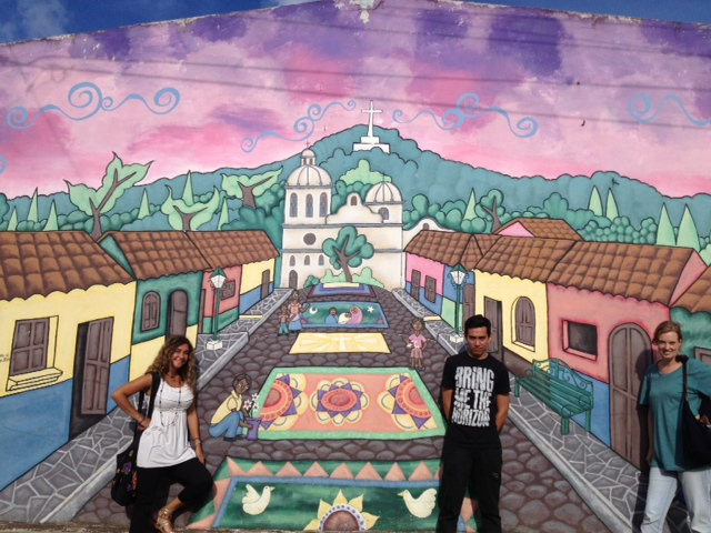 One of the many beautiful murals in El Salvador with Carlitos.