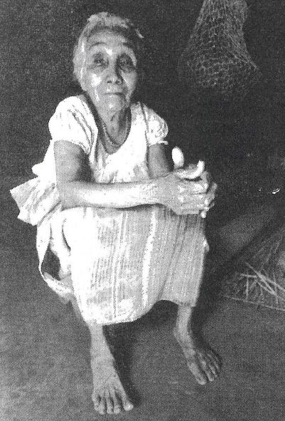 Photo: Sonsonate, El Salvador. This 90-year-old woman lost most of her family members in the Matanza of 1932. She not only survived, but was one of the few to resist assimilation into the Spanish creole culture. She speaks Nahuatl. The fabric in her skirt is from Guatemala. There are no longer weavers who make traditional huipiles or dress in El Salvador. © Donna Decesare, 1990.