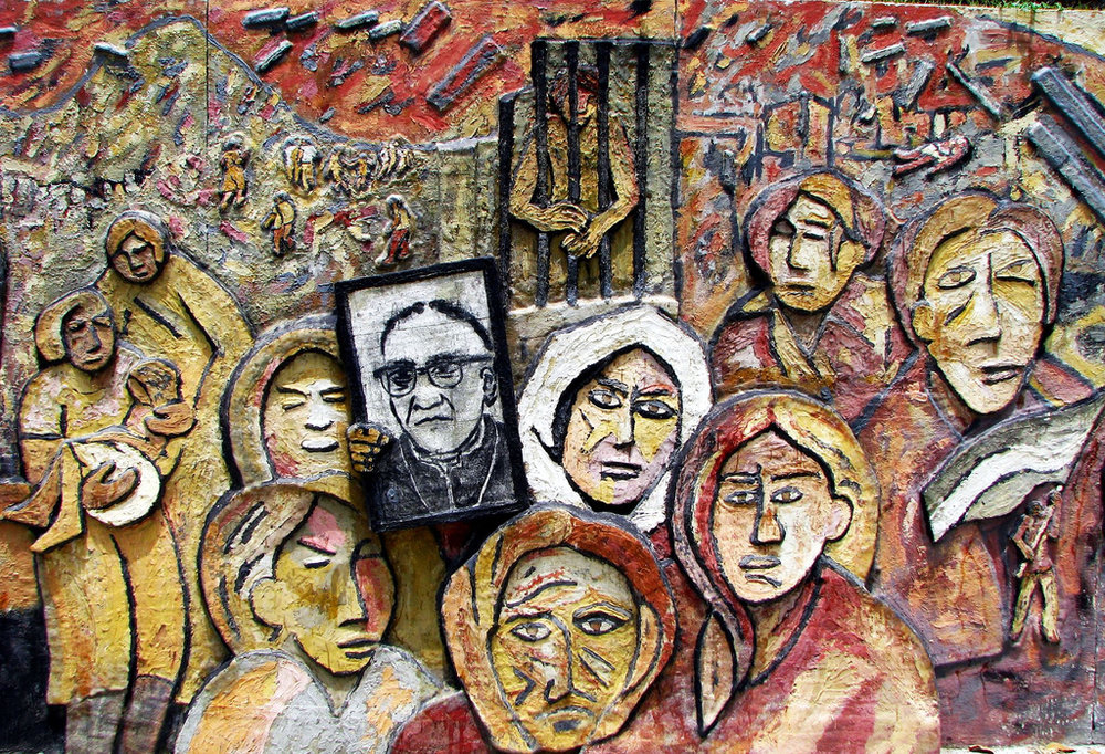 Mothers of the Disappeared hold a picture of Archbishop Oscar Romero in a section of the Monument to Memory and Truth, Parque Cuscatlan, San Salvador, El Salvador. © Walkyman.