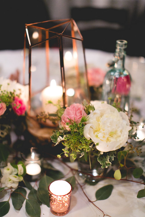 Wedding table design with flowers and candles