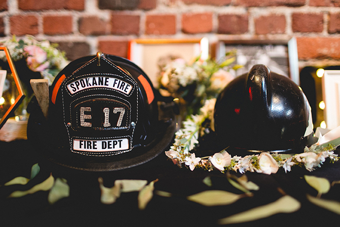 Wedding specialty floral arrangement with fire department helmets