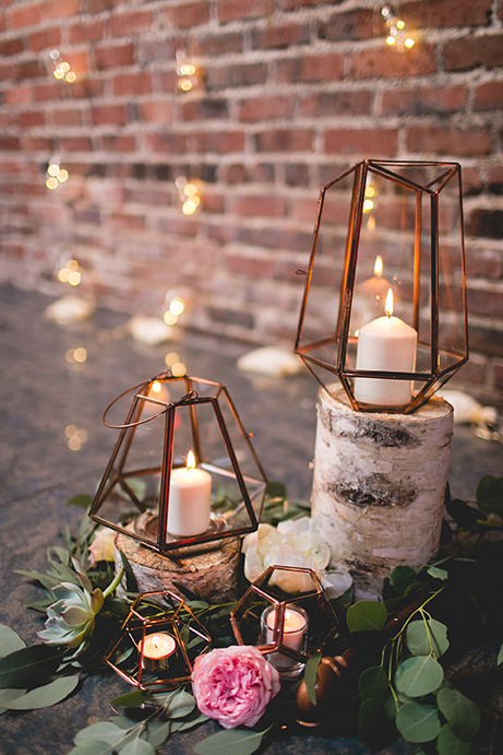Wedding table with flowers, candles, and birch