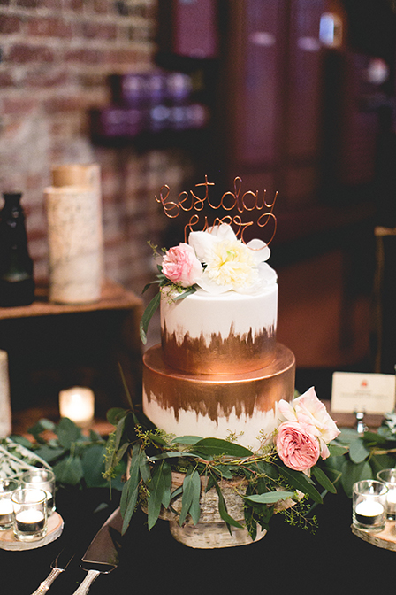 Wedding cake with flowers on birch pedestal