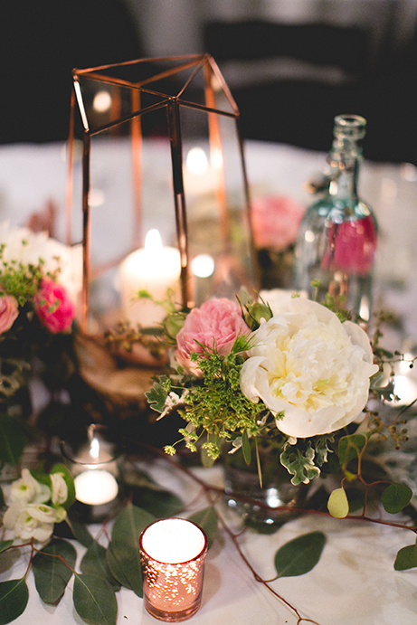 Wedding floral arrangement on table with candles