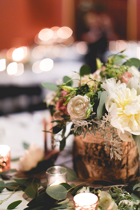 Wedding floral design on table with candles