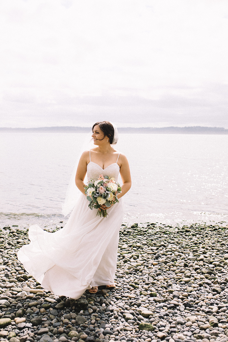 Bride with bouquet at the beach