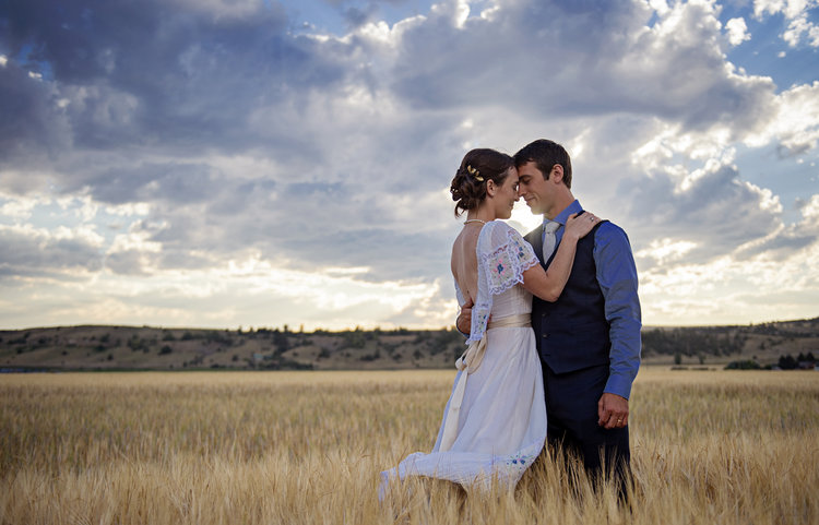 Groom and bride in field