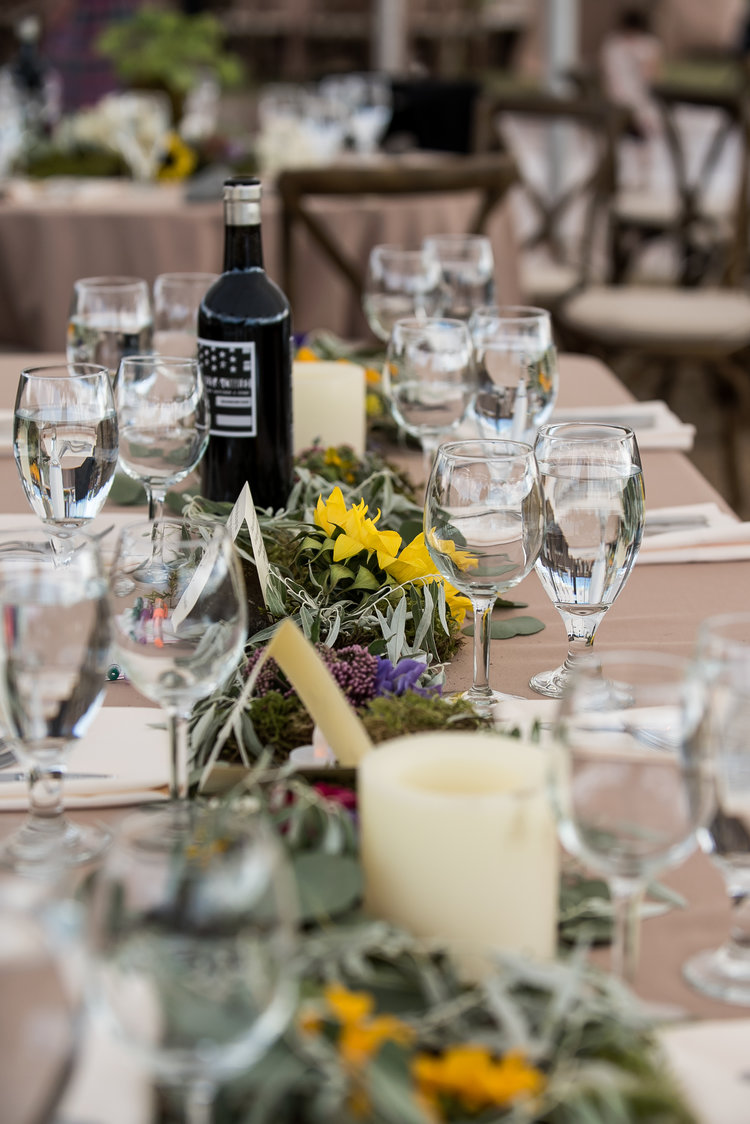 Wedding tablescape with greens and sunflowers