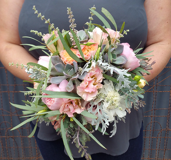Wedding bouquet design with succulents and pink, white, and green flowers