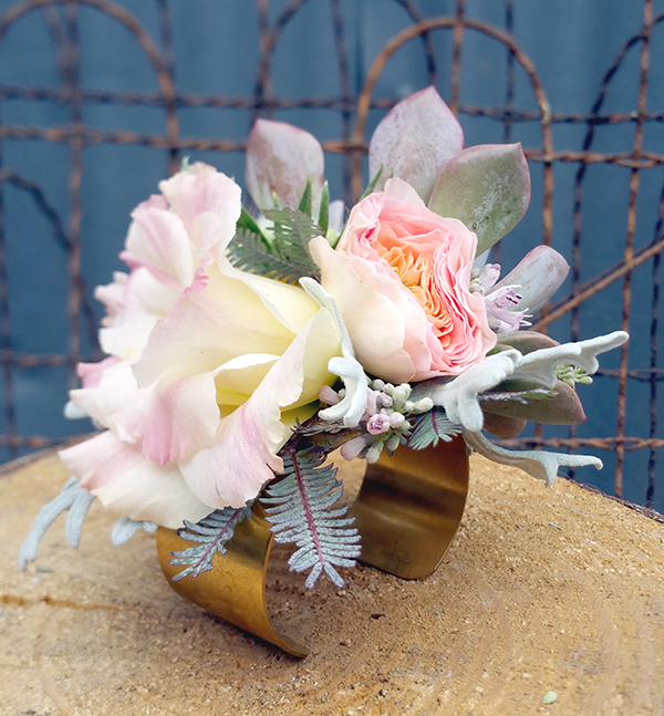 Corsage with succulents and pink flowers