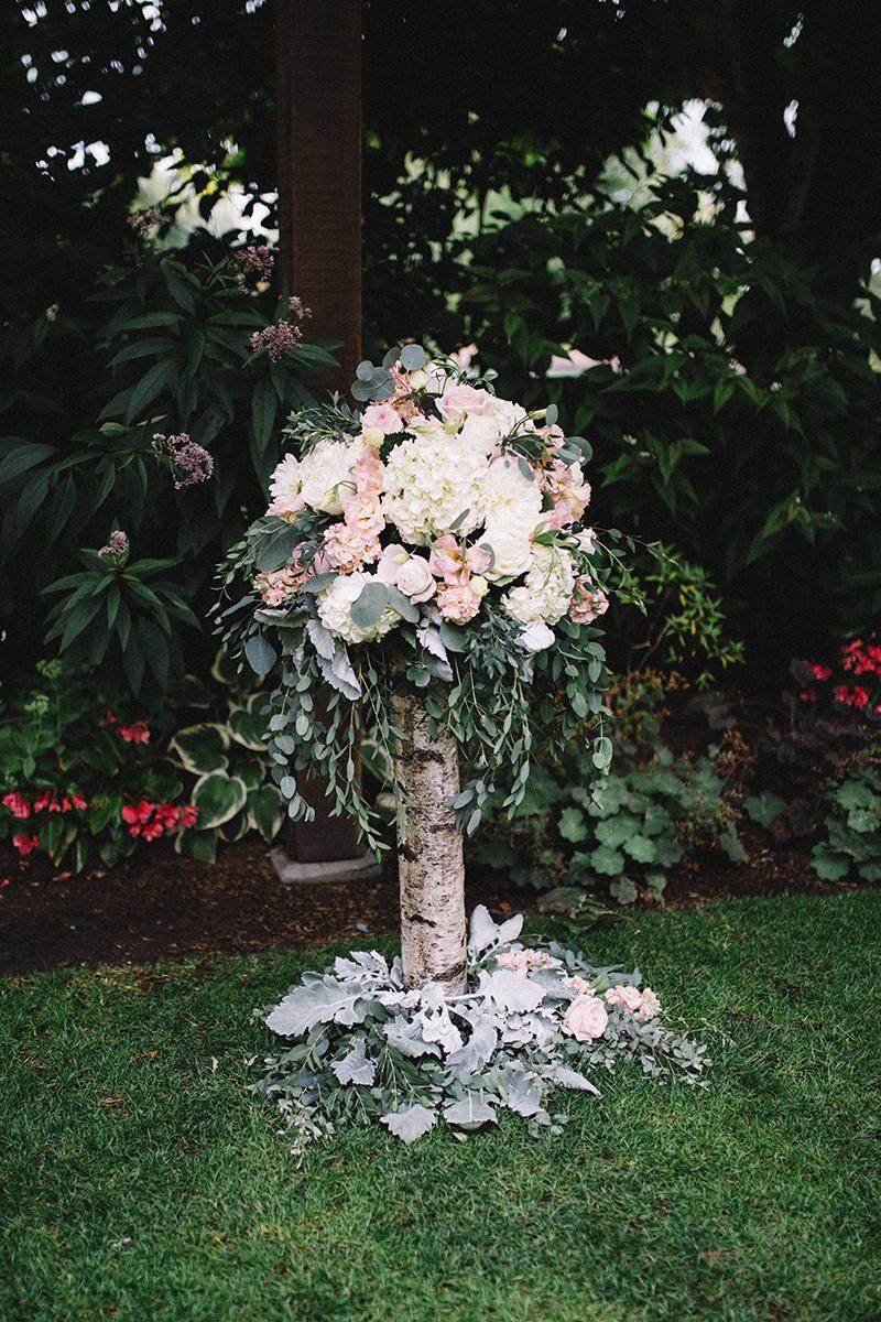 Wedding floral design using birch pieces