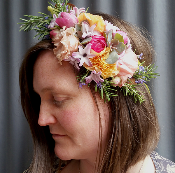 Floral crown with white, pink, and yellow flowers
