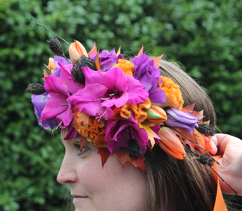 Floral crown with pink, yellow, and purple flowers