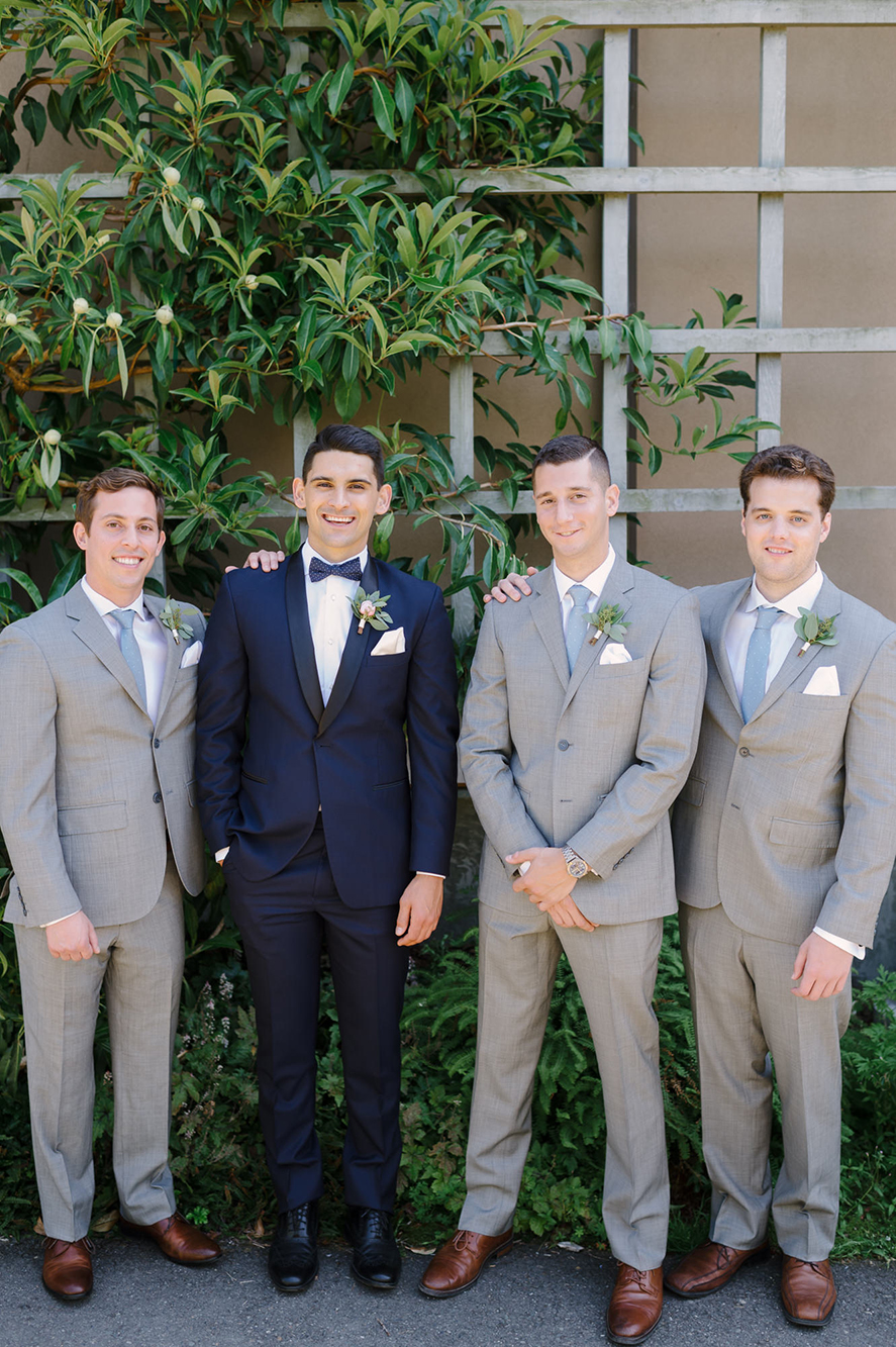 Grooms party with boutonnieres